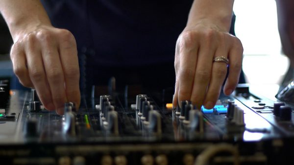 A woman's hands using mixing equipment