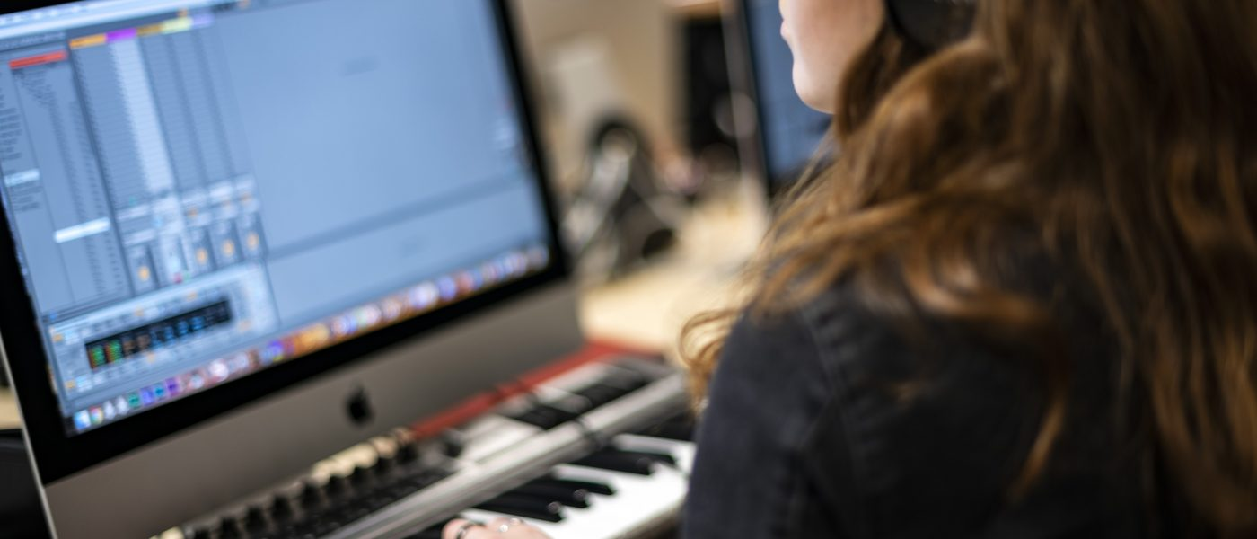 Woman using a digital audio workstation