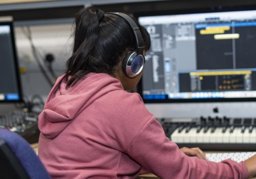 girl using music software on a computer